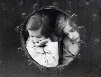 Two children look through the ship's porthole